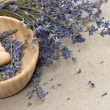 Wooden mortar with dry lavender flowers — Stock Photo