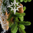 Christmas tree with shiny silver star decoration — Stock Photo