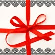 Gift card with red ribbon and lace frame - Foto Stock