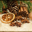 Christmas decoration with cinnamon sticks and anise stars — Stock Photo
