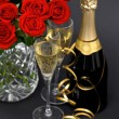 Red roses and champagne. festive decoration — Stock Photo