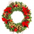 Christmas wreath with poinsettia flowers and golden decoration — Stock Photo #13994324