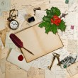 Old accessories, post cards and holly berry — Stock Photo
