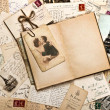 Stock Photo: Old papers, french post cards and open diary book