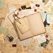 Stock Photo: Old letters, french postcards from Paris and open book