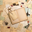 Old letters, french postcards from Paris and open book — Stock Photo