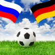 Football field and naional flags of germany and russia — Stock Photo
