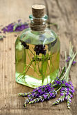 Essential lavender oil with fresh flowers — Stock Photo