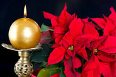 Red christmas star with golden candle — Stock Photo