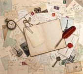 Empty open book, old accessories and post cards — Zdjęcie stockowe