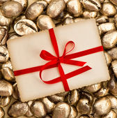 Gift card with red ribbon with coffee beans — Stock Photo