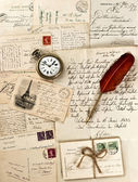 Letters and post cards with vintage clock — Stock Photo