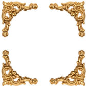 Golden elements of carved frame on white — Stock Photo