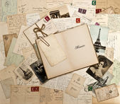 Old letters, french post cards and open book — Stock Photo