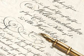 Handwritten text and antique ink pen — Stock Photo