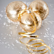 Golden christmas balls with snow decoration — Stock Photo #14003652