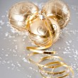 Golden christmas balls with snow decoration — Stock Photo