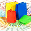 Royalty-Free Stock Photo: Shopping bags over euro currency banknotes