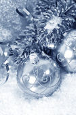Silver christmas balls with christmas tree branch — Stock Photo