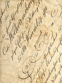 Vintage calligraphy on drunge paper — Stock Photo