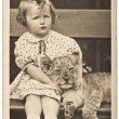 Portrait from little girl with tiger baby — Stock Photo #14075739