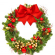 Stock Photo: Christmas wreath with red ribbon and golden decoration