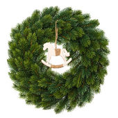 Christmas wreath with wooden rocking horse — Stock Photo