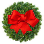 Green christmas wreath with red ribbon bow — 图库照片