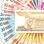 Old greek drachma and euro cash notes. euro crisis concept — Stock Photo #14176850
