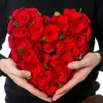 Flowers bouquet in heart shape — Stock Photo