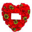 Red heart of roses with clover leaves and white card — Stock Photo