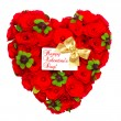 Heart shaped red roses with golden ribbon and white card — Stok fotoğraf