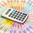 Calculator on euro banknotes background — Stock Photo #14177042