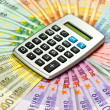 Calculator on euro banknotes background — Stock Photo
