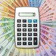 Calculator on euro banknotes background — Stock Photo #14177122