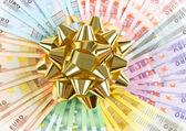 Money as a gift. golden ribbon on euro banknotes — Stock Photo