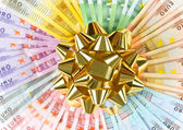Money as a gift. golden ribbon on euro banknotes — Stock Photo