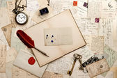 Open book, old keys, clock and postcards — Stock Photo