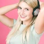 Beautiful blonde girl listening to music — Stock Photo #14468047