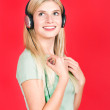Beautiful blond smile girl with headphones — Stock Photo