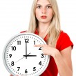 Stock Photo: Young businesswomwith clock