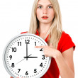 Young businesswoman with a clock — Stock Photo