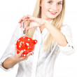 Friendly woman with red piggy savings bank — Stock Photo #14468107