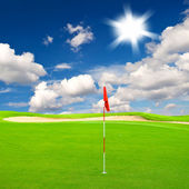 Golf field with cloudy blue sky background — Stock Photo
