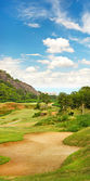 Beautiful golf field landscape with cloudy blue sky — Stock Photo