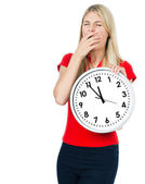 Tired young woman with the clock. five to twelve — Stock Photo