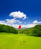 Golf course and blue sky — Photo