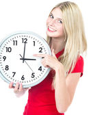 Young woman holding a clock. time management concept — Stock Photo