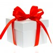 White gift box with red bow ribbon — Stock Photo #14488721