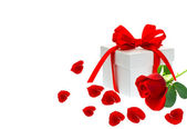 Gift box with ribbon bow with red rose — Stock Photo